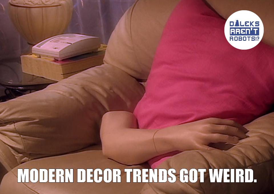 (Image of a mannequin arm on a cushy chair next to a pink throw pillow) Modern decor trends got weird.