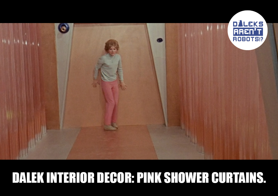 (Image of Barbara against a wall surrounded by pink plastic) Dalek interior decor: Pink shower curtains.