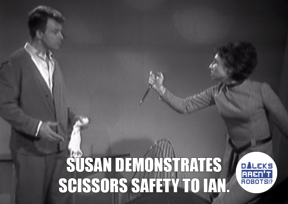 (Image of Susan threatening Ian with scissors) Susan demonstrates scissors safety to Ian.