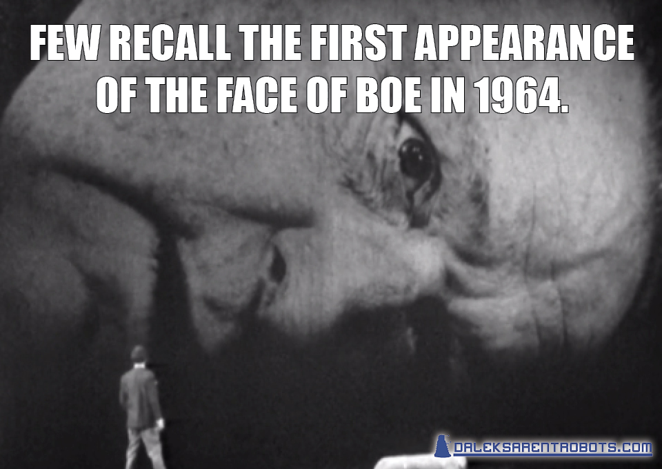 (Image of giant face rear projected behind Ian) Few recall the first appearance of the Face of Boe in 1964.